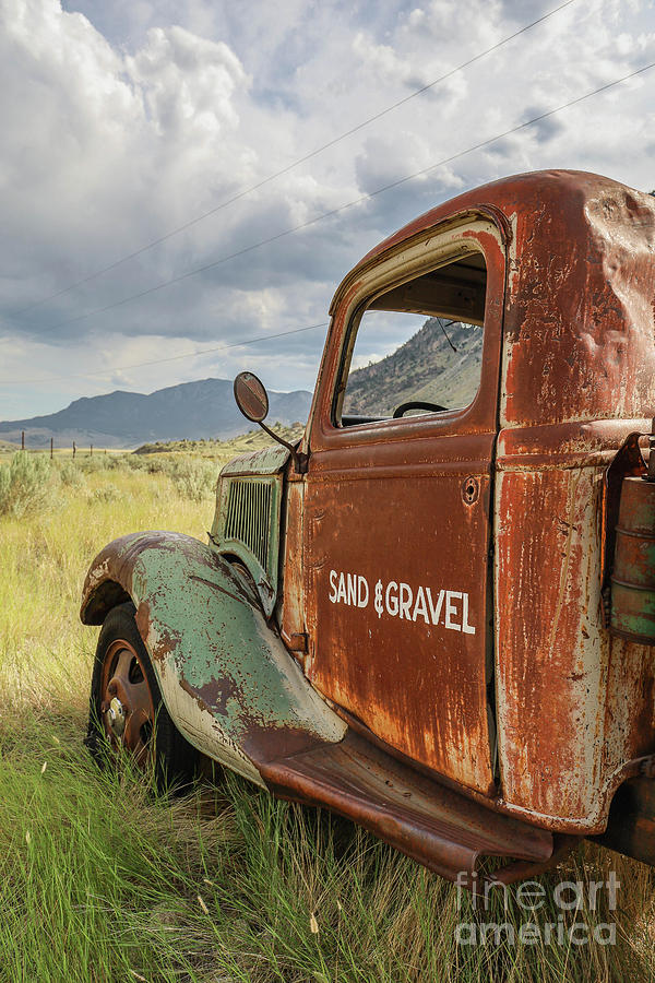 Rusty Photograph - Sand And Gravel Vintage Truck West Yellowstone Montana by Edward Fielding