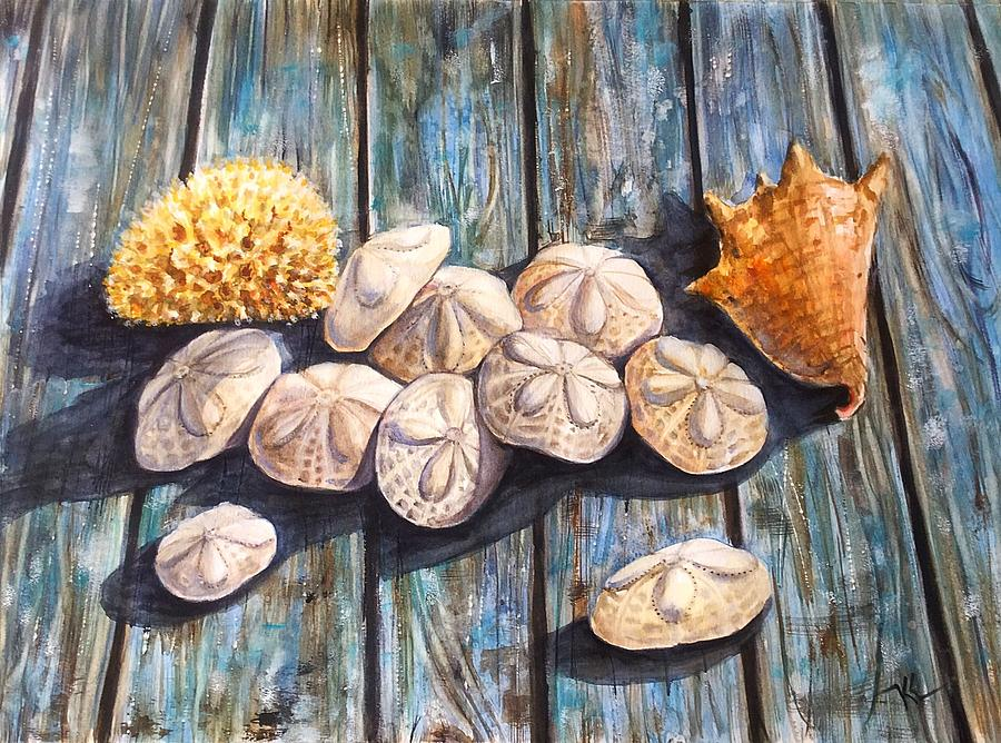 Sand dollars and shell by Katerina Kovatcheva