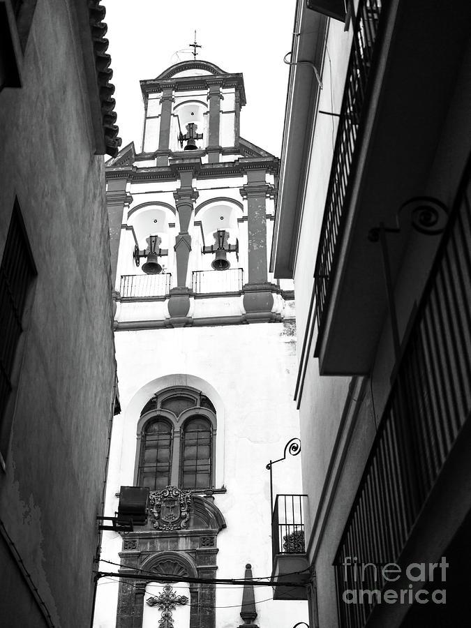 Santa Cruz Church Bell Tower in Seville by John Rizzuto