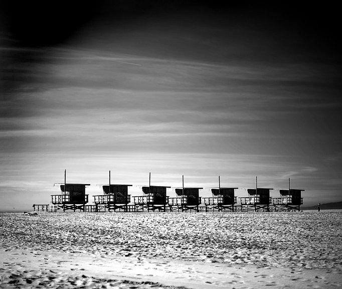 Santa Monica Lifeguard Towers In A Row Photograph by Stephen Albanese