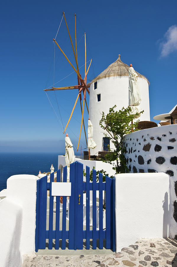 Santorini Windmill With Blue Fence Photograph by Arturbo