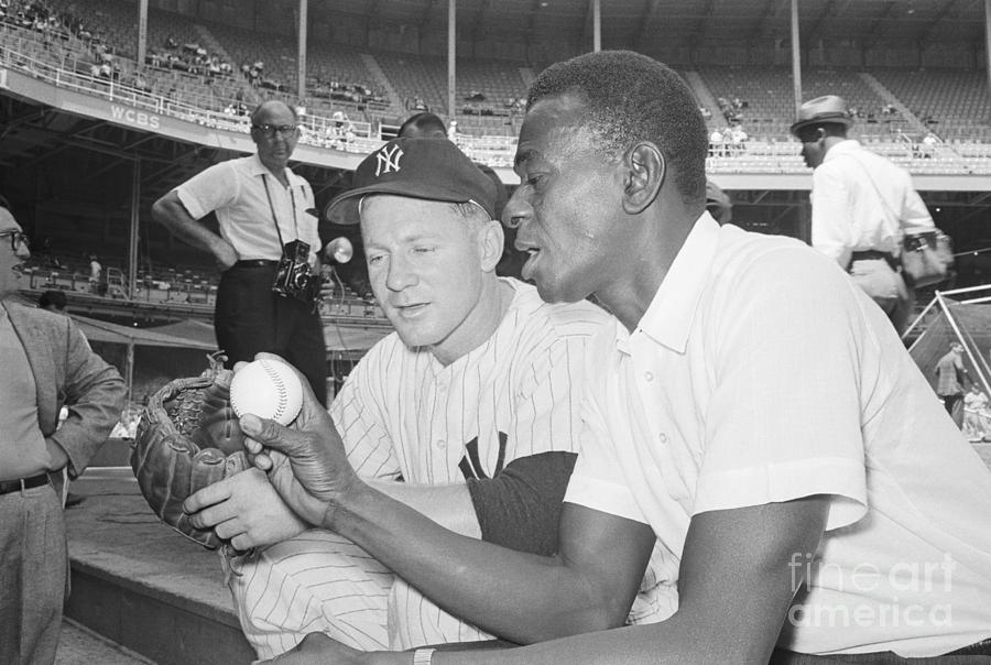 Satchel Paige Advising Whitey Ford Photograph by Bettmann