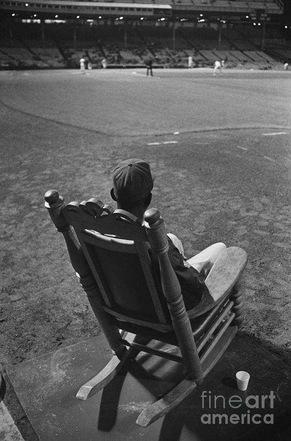 Satchel Paige Sitting In Rocking Chair Photograph by Bettmann