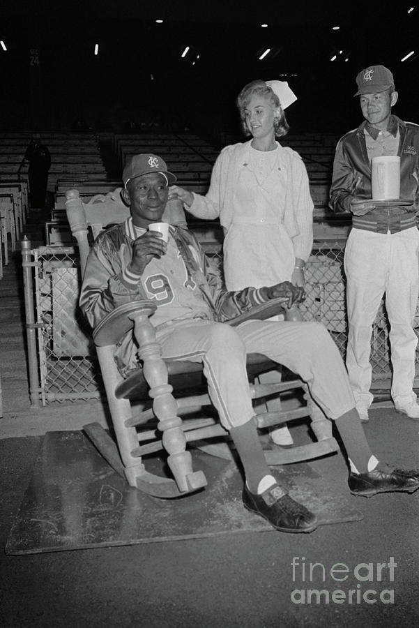 Satchel Paige Sitting On A Chair Photograph by Bettmann