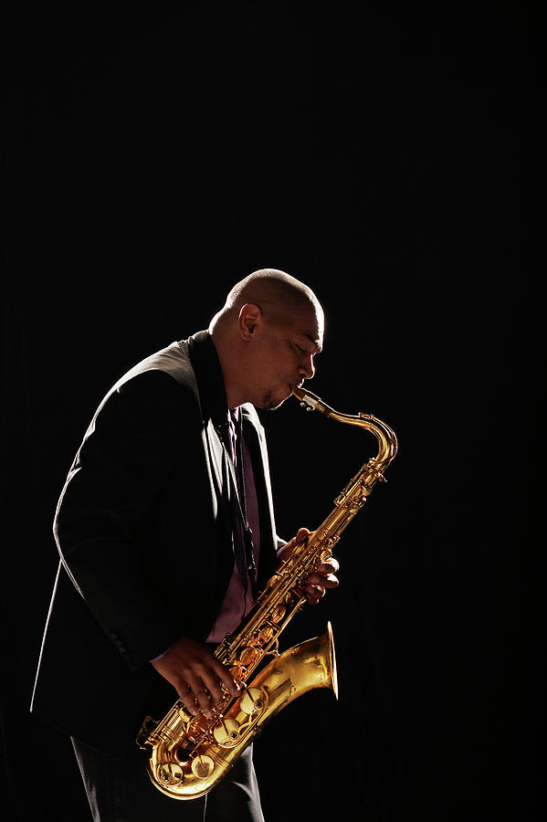 Saxophone Player Performing Photograph by Moodboard