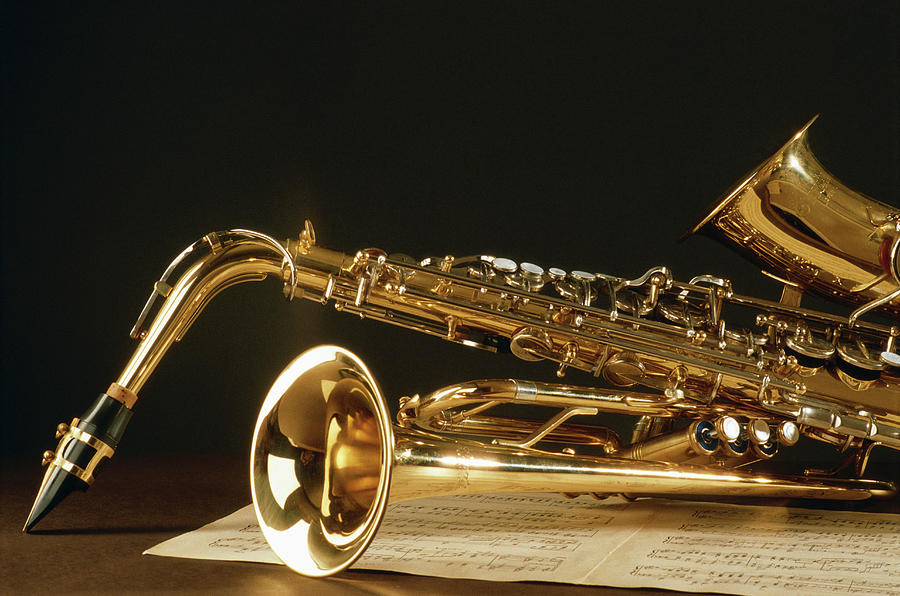 Saxophone With Music Sheet Photograph by David De Lossy
