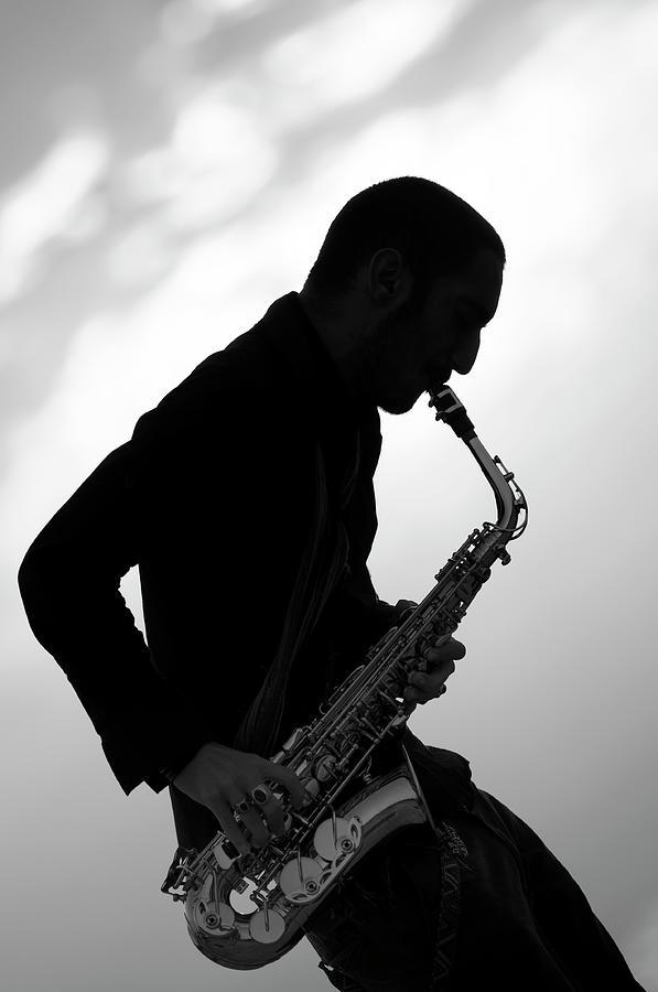Saxophonist Photograph by Emreogan