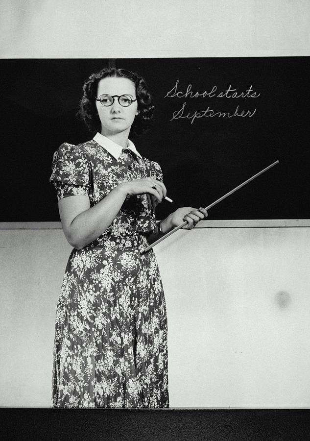 School Teacher Standing In Front Of Photograph by Archive Holdings Inc.