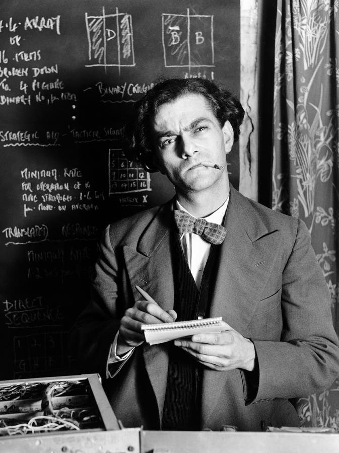Scientist By Blackboard Covered In Photograph by Hulton Archive
