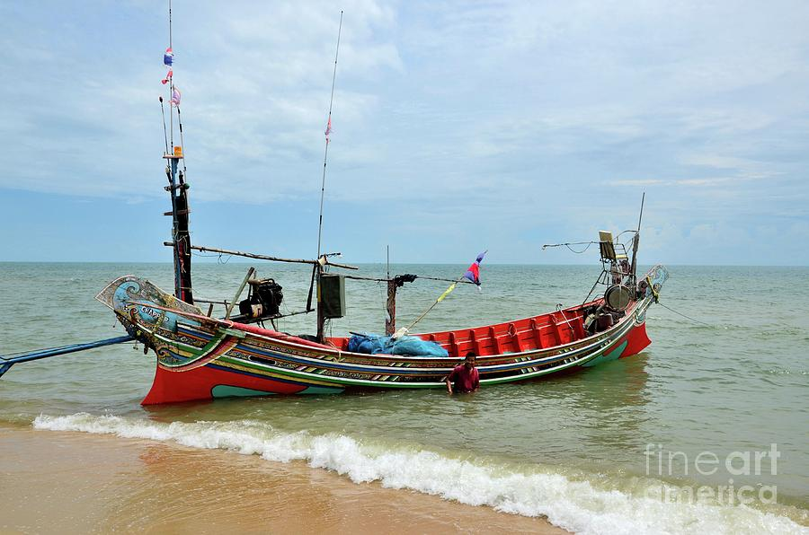 Sea going fishing vessel boat parked on beach in Pattani village Thailand by Imran Ahmed