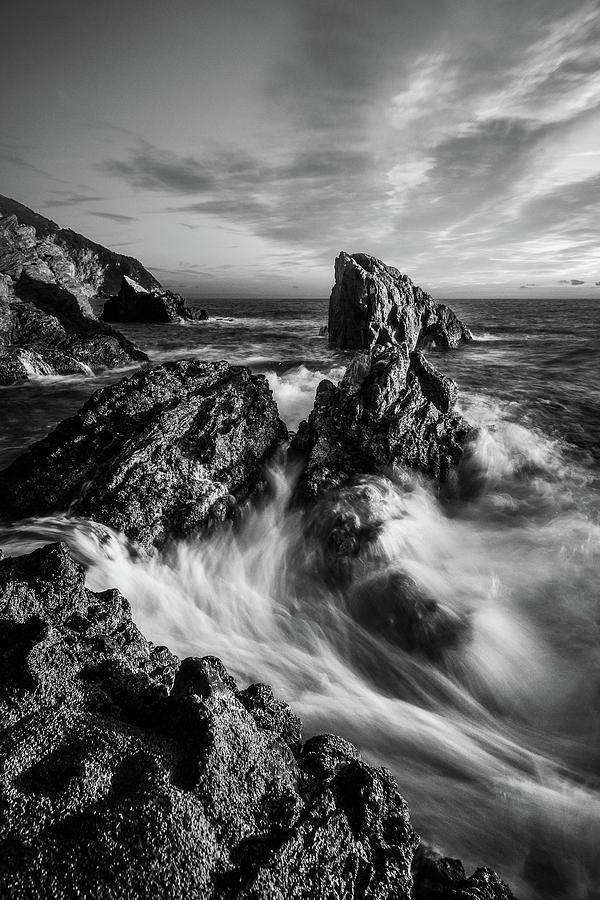 Sea waves flowing on rocks in Manarola, black and white fine art by Matteo Viviani