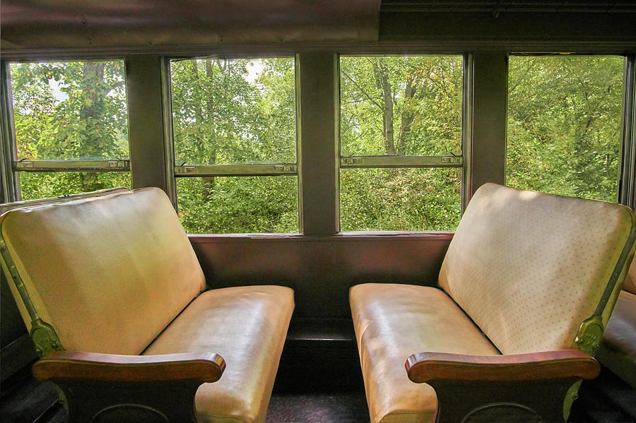 Seats in a vintage railroad car by Jim Hughes