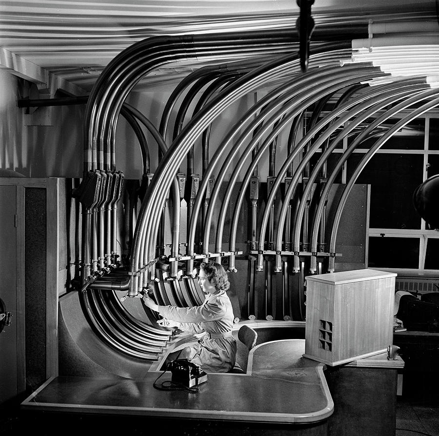 Secretary With Pneumatic Tube Photograph by Walter Nurnberg