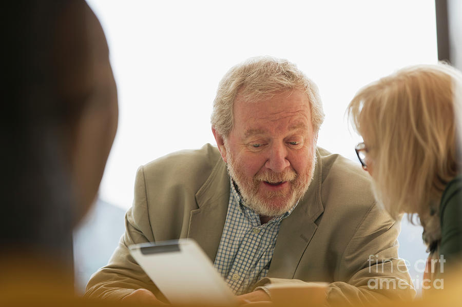 Active Seniors Photograph - Senior Business People Using Digital Tablet In Meeting by Caia Image/science Photo Library