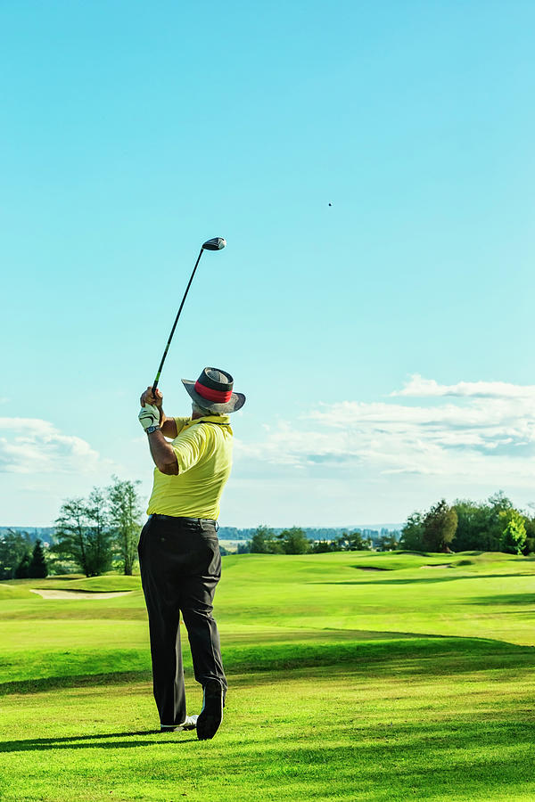 Senior Golfer On Golf Course Teeing Off Photograph by Jhorrocks