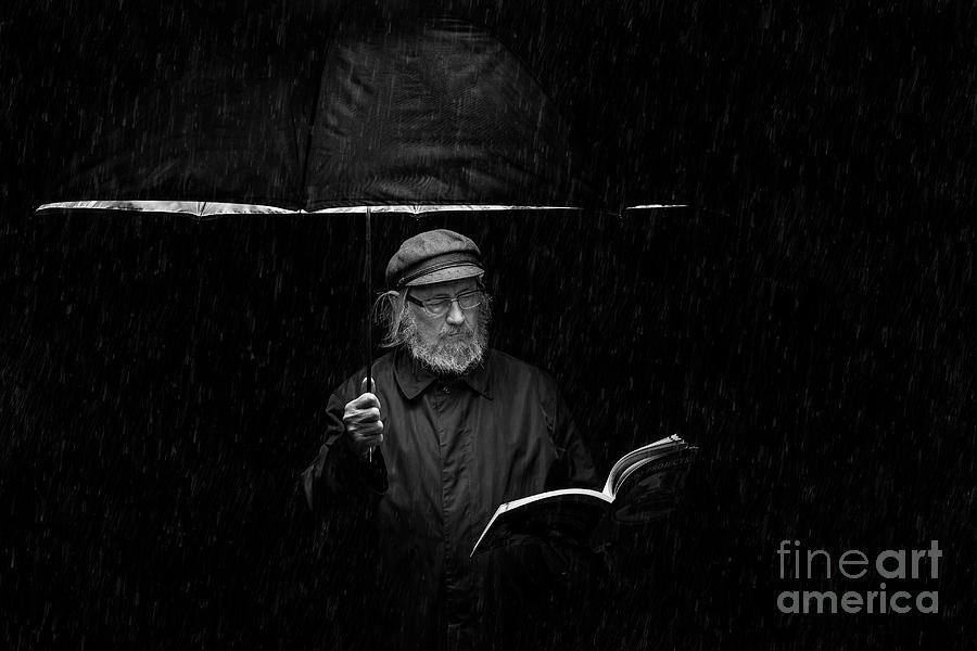 Senior Man Reading Book Under Umbrella Photograph by Etienne Tremblay