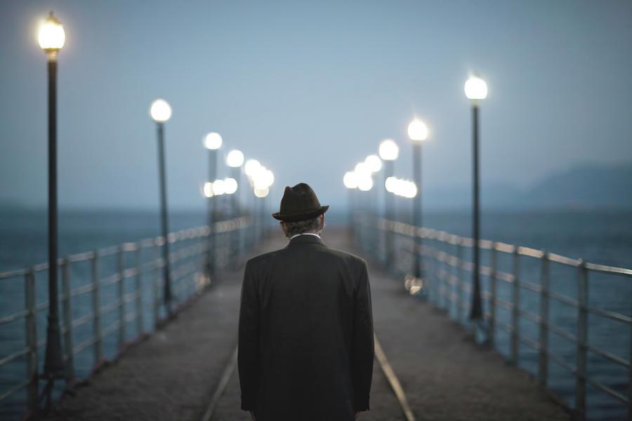 Senior Man Standing On A Bridge Photograph by Thanasis Zovoilis