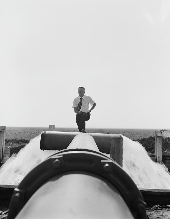 Senior Man Standing On Water Pipe Near Photograph by Tom Kelley Archive