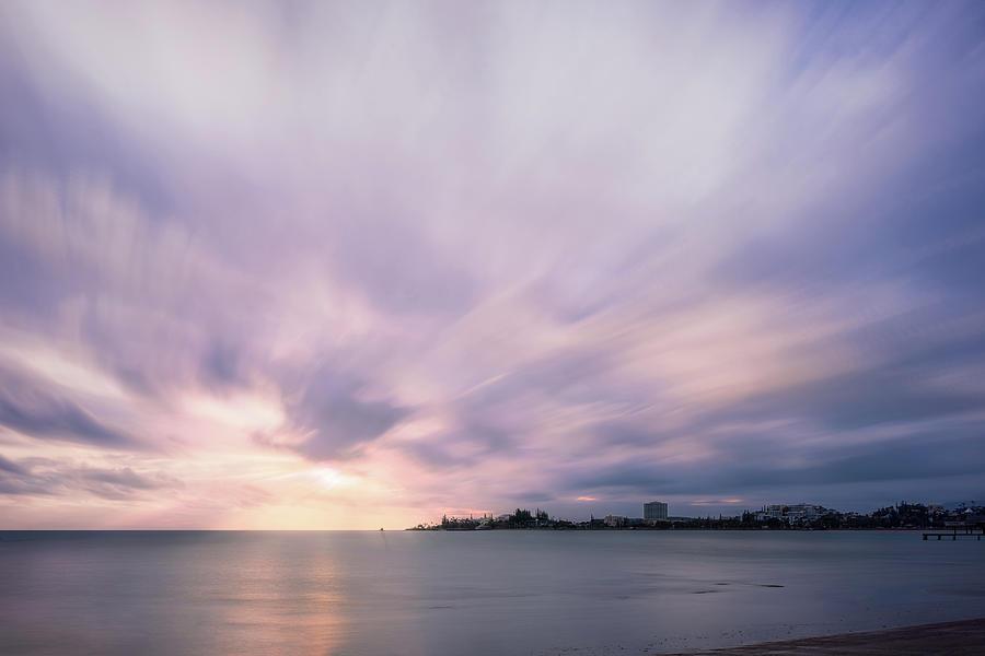 Serene Sunset at Anse Vata Bay in New Caledonia. by Daniela Constantinescu
