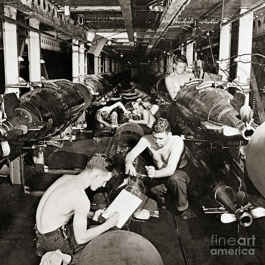Servicemen preparing torpedoes to be installed in submarines, 1944  by American School
