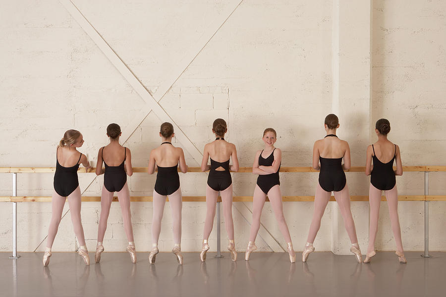 Seven Girls 11-13 Standing On Toes At Photograph by David Fischer