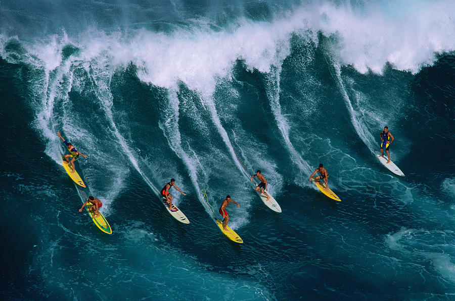 Seven Surfers Riding Large Wave Photograph by Warren Bolster