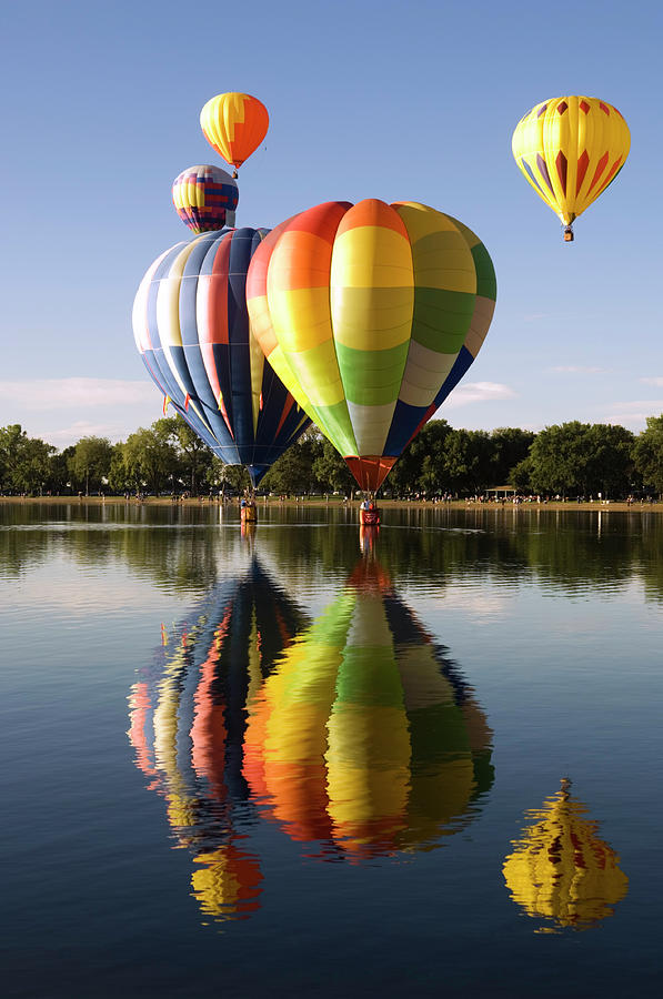 Several Reflected Balloons Photograph by Bwbimages