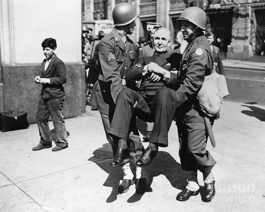 Sewell Avery Carried By Two Soldiers Photograph by Bettmann