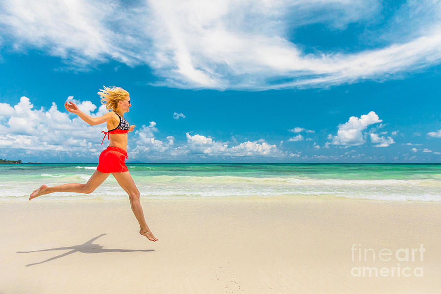 Seychelles carefree woman by Benny Marty