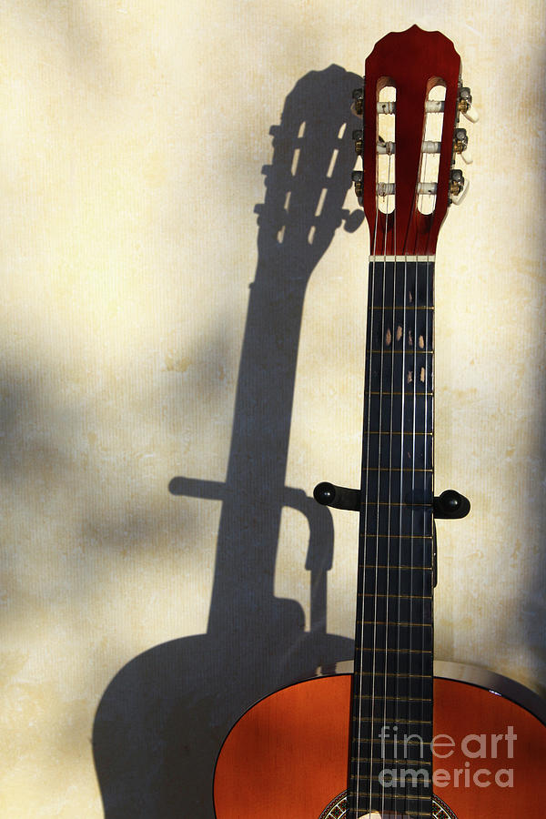 Shadow of an acoustic guitar by Gregory DUBUS
