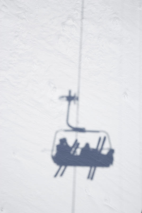 Shadow Of Chair Lift With Skiers Photograph by Stefan Schuetz / Look-foto