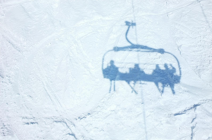 Shadow Of Skiers On Chair Lift Over Photograph by Cjp