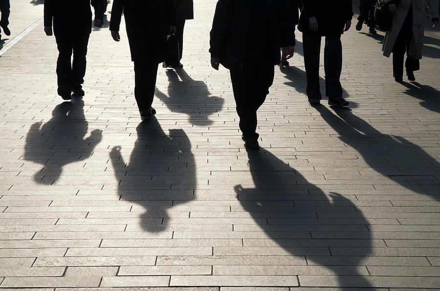 Shadow Team Of Commuters Walking On Photograph by Peskymonkey