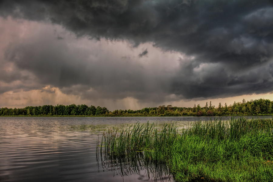 Shafts Of Rain Over Lost Lake by Dale Kauzlaric
