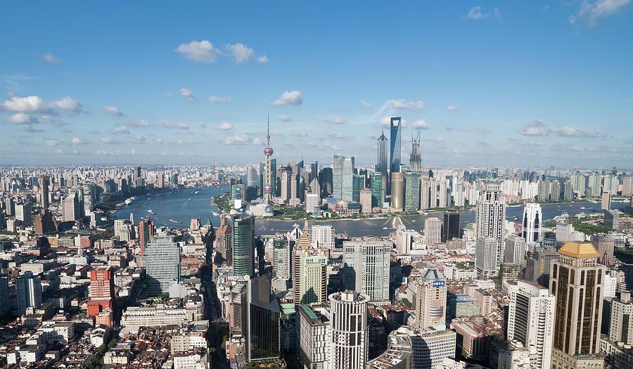 Shanghai Skyline Across The Huangpu Photograph by Hugociss