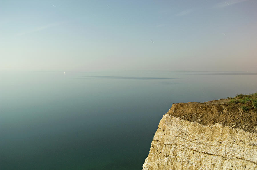 Sharp Edge Of A Cliff Overlooking The Photograph by Andre Lichtenberg