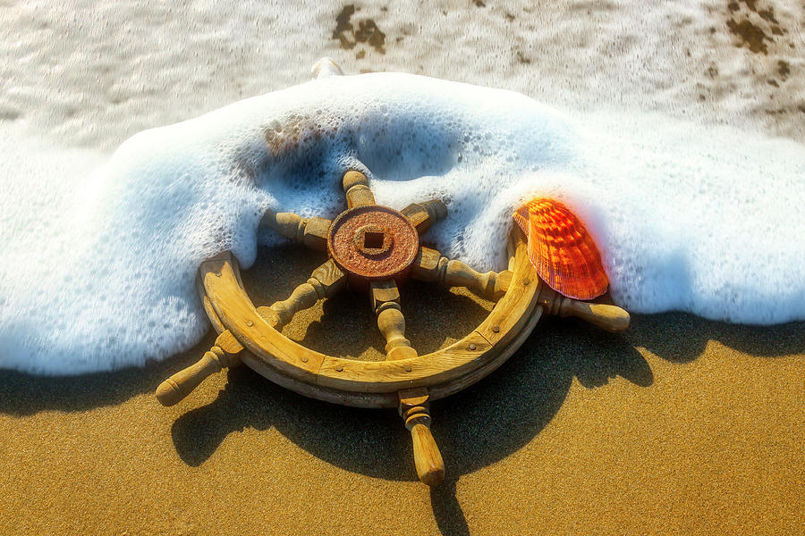 Ships Wheel In Tide by Garry Gay