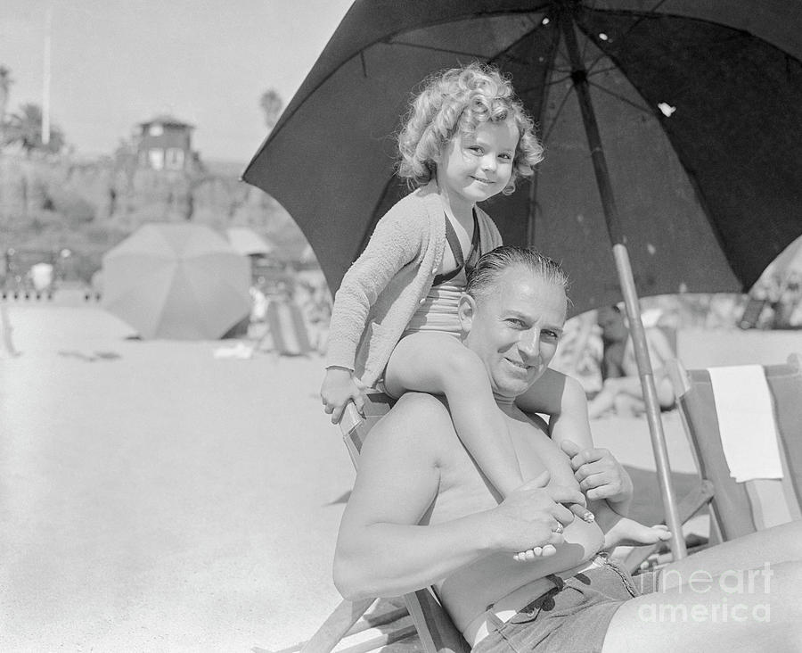 Shirley Temple Sitting On Fathers Photograph by Bettmann