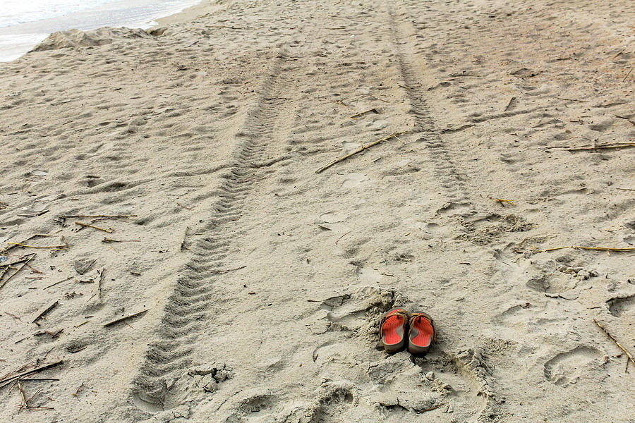 Shoes Tire Tracks And Footprints Photograph