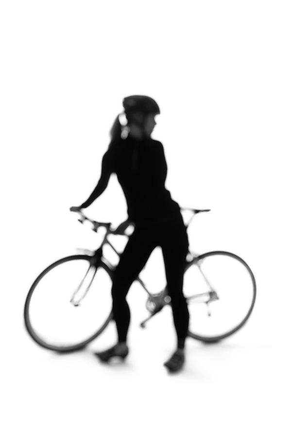 Silhouette Of A Woman With A Bicycle Photograph by Peter Rutherhagen