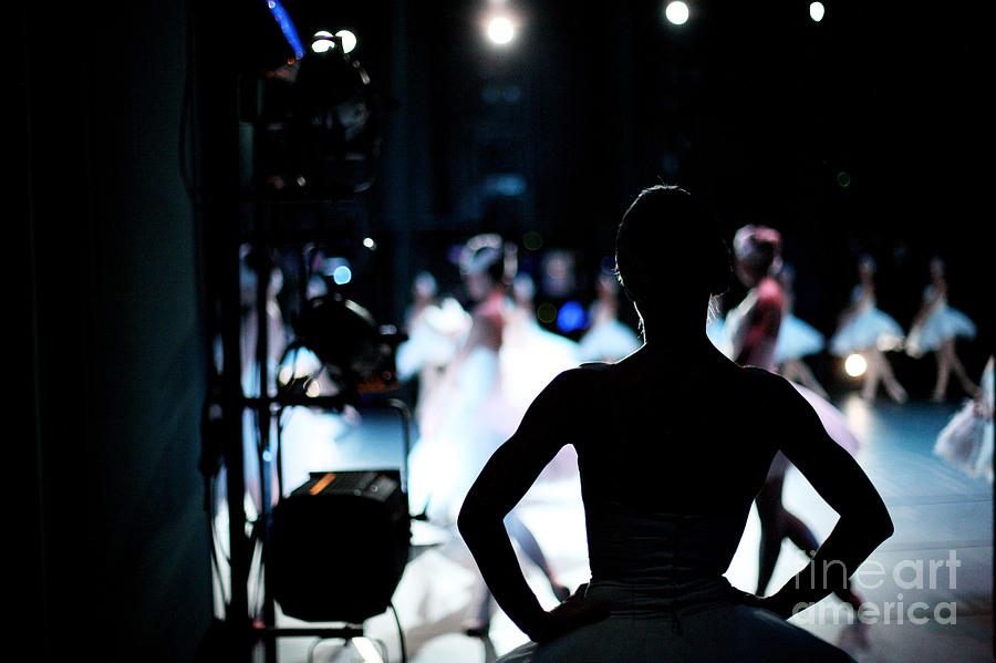 Behind Photograph - Silhouette Of Ballerina On Background by Anna Jurkovska