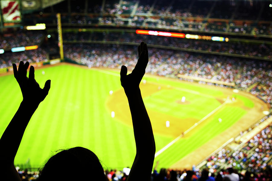 Silhouette Of Baseball Fan Waving Hands Photograph by Thomas Northcut