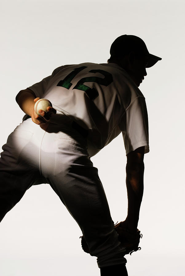 Silhouette Of Baseball Pitcher Holding Photograph by Pm Images