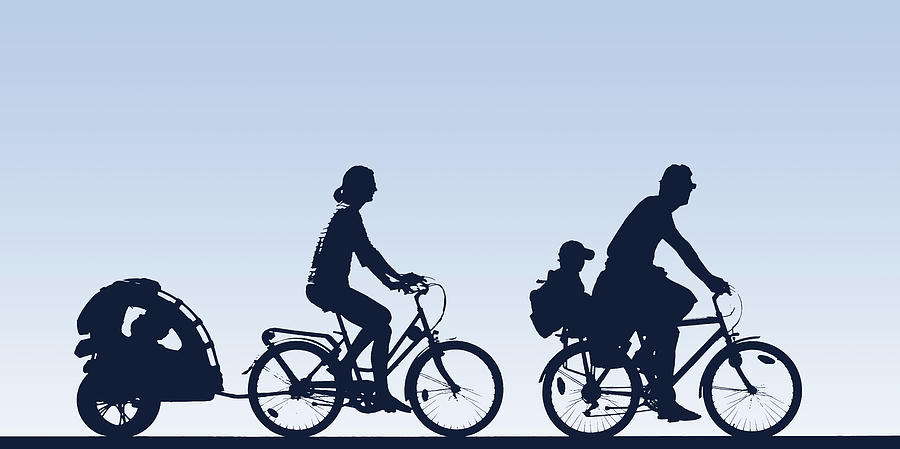 Silhouette Of Family Riding Bikes Photograph by Jacques Loic