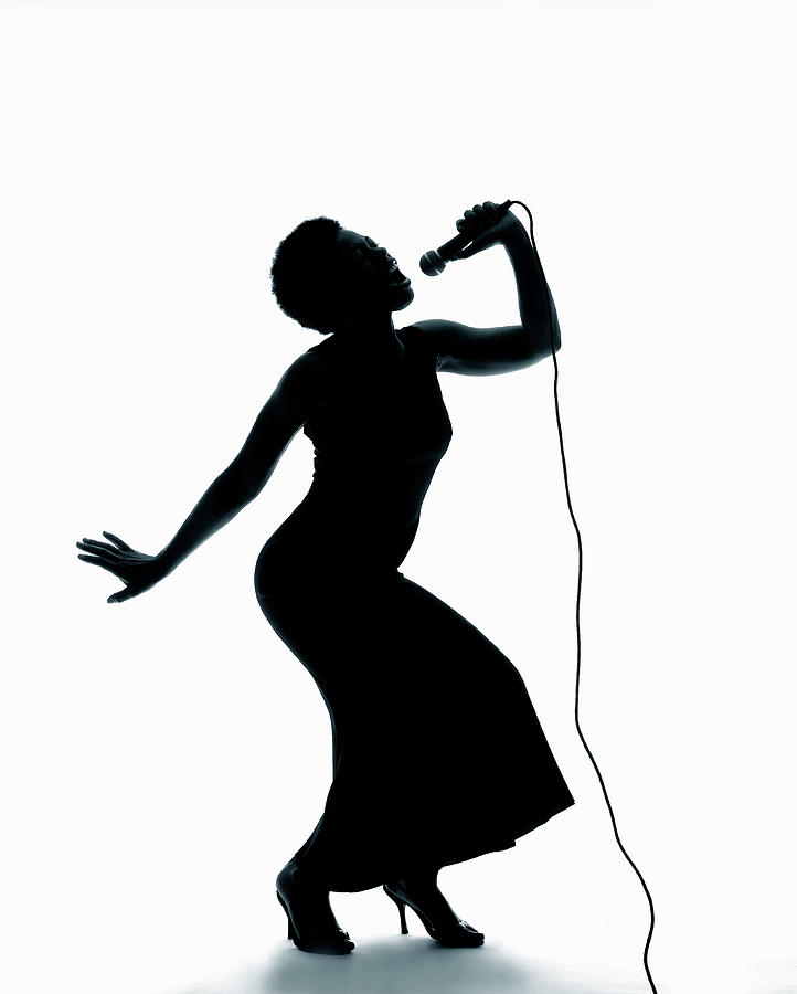 Silhouette Of Female Singer Singing On Photograph by Pm Images