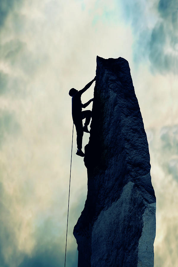 Silhouette Of Man Climbing Rock Photograph by Steve Mcalister