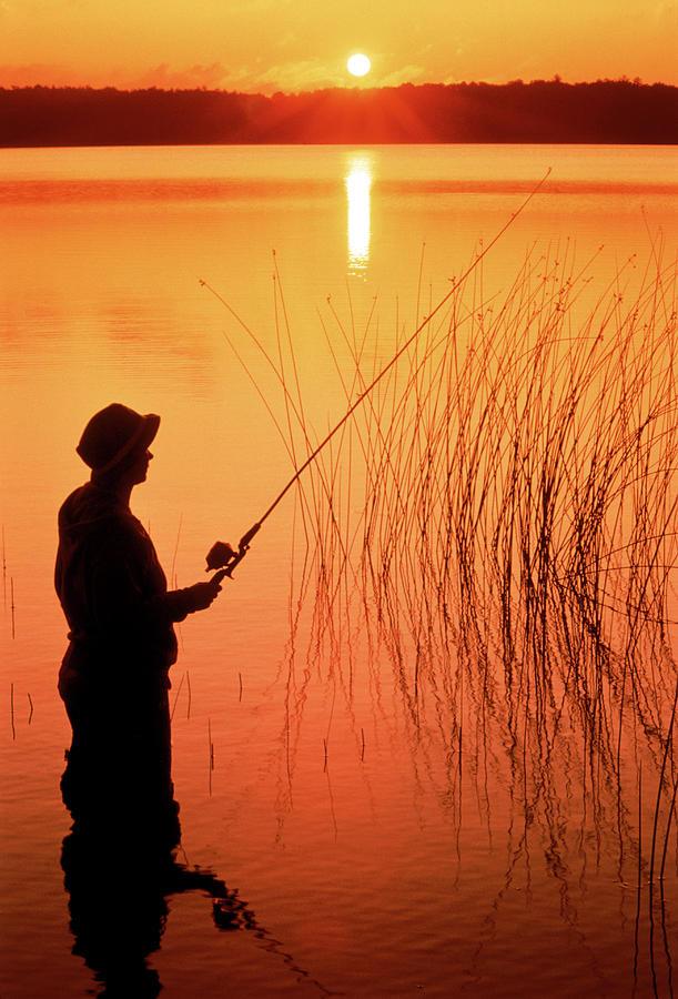 Silhouette Of Man Fishing, Vilas City Photograph by Ken Wardius