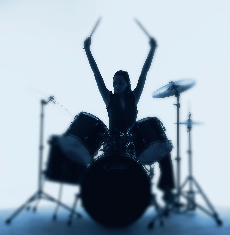 Silhouette Of Woman Playing Drums Photograph by Pm Images