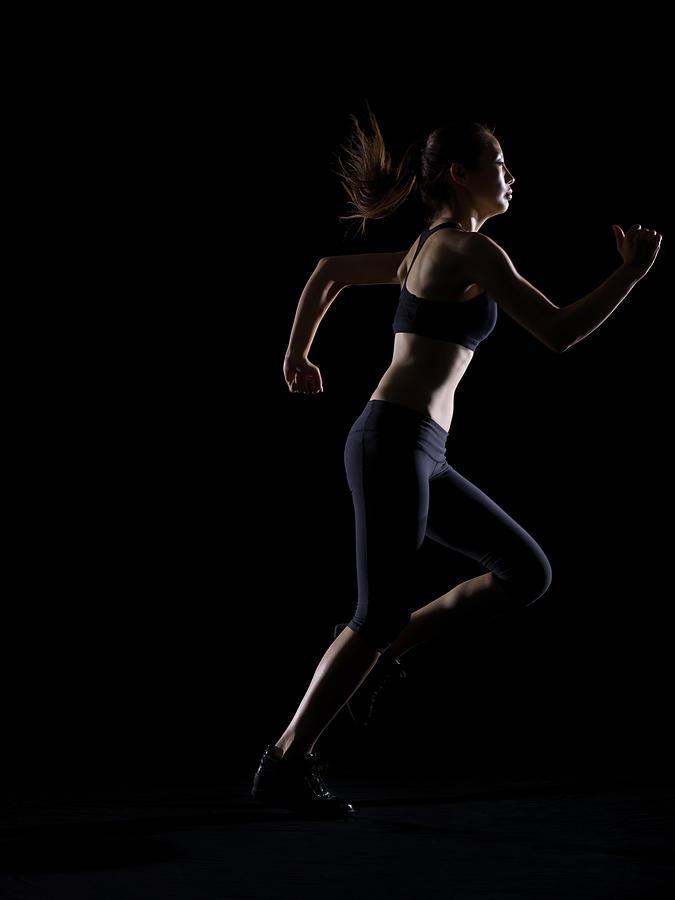 Silhouette Of Woman Running Photograph by Kokouu