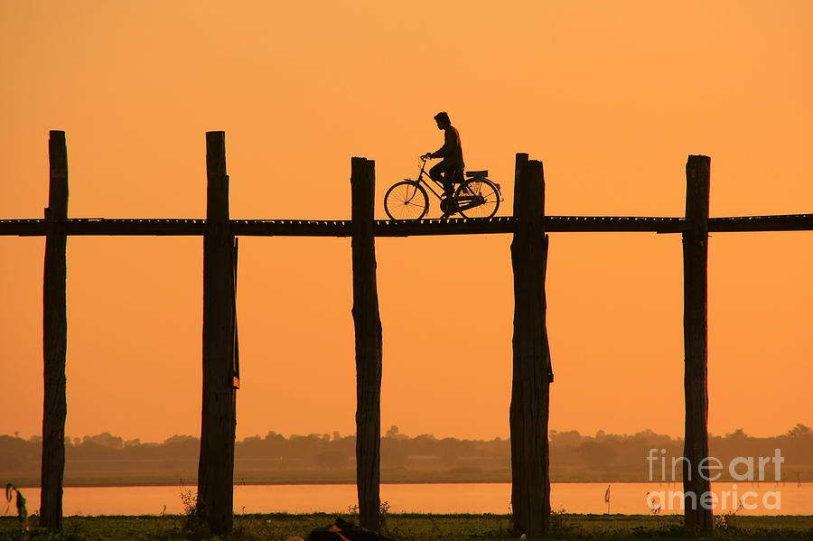 Sunrise Photograph - Silhouetted Person With A Bike On U by Don Mammoser
